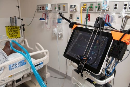 Robotic System Remotely Controls Ventilators in COVID-19 Patient Rooms
